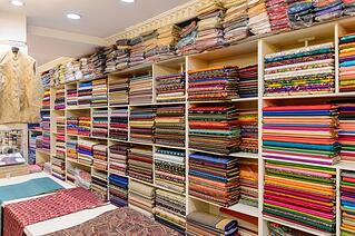 stock-photo-jaipur-india-jan-interior-of-the-carpet-and-silk-shop-near-jaipur-india-indian-381924607.jpg